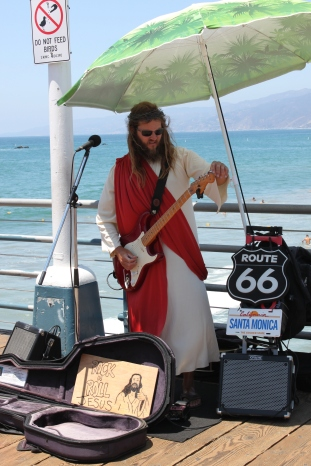 "I saw ""Rock and Roll Jesus"" this summer at Santa Monica Beach in southern California. When I say Jesus sang, this is NOT what I mean."