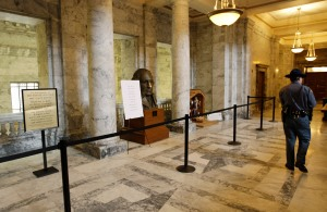 Atheist- and religious-themed signs on display in the state capitol in Olympia, Wash. (AP Photo/Ted S. Warren)